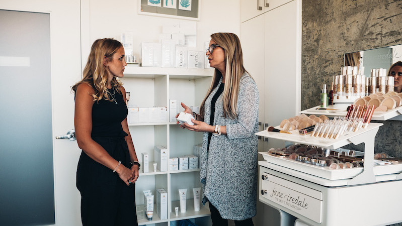 Skin care product consultation at INLIV in Calgary